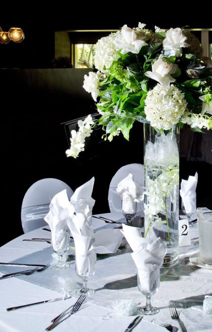white bouquet beautiful table setting